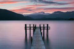 Romantic wharf on Te Anau on South Island of New Zealand Beautiful pier on sunrise. Lake Te Anau is the largest lake. royalty free stock images