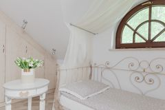 Romantic white canopy bed Stock Photography