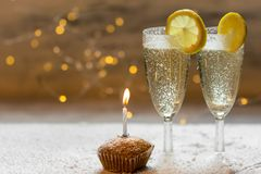Romantic, white and golden winter background with two glasses of champagne and wedding rings royalty free stock photos