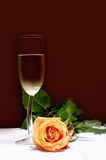Romantic. White wine glass with rose Royalty Free Stock Images