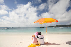 Romantic Whitehaven beach. A couple relaxing on the beach in Whitsunday island Royalty Free Stock Photo