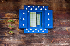 Romantic window on wooden wall Stock Photography