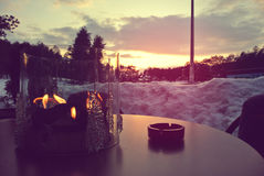 Romantic winter evening in an open air cafe Stock Photos