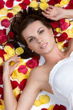 Romantic Woman. Laying in petals Royalty Free Stock Images