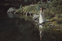 Romantic woman and alpine lake Royalty Free Stock Photo
