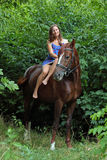 Romantic woman bareback riding in evening Stock Image