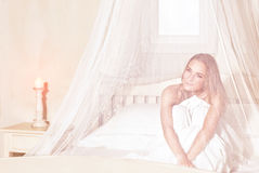 Romantic woman in the bed Royalty Free Stock Image
