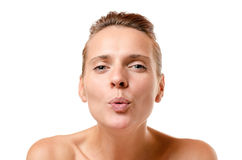 Romantic woman blowing a kiss at the camera Royalty Free Stock Photo