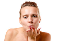 Romantic woman blowing a kiss at the camera Royalty Free Stock Images