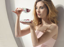 Romantic woman with a cup stock photos