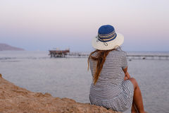 Romantic woman enjoying the breeze at the seaside Stock Images