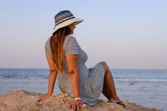 Romantic woman enjoying the breeze at the seaside Royalty Free Stock Photography