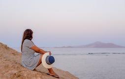 Romantic woman enjoying the breeze at the seaside Stock Photography