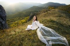 Romantic woman on field Stock Photos
