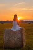 Romantic woman in field with hay Stock Photography