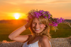 Romantic woman in field with hay Stock Photos