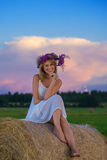 Romantic woman in field with hay Royalty Free Stock Photos