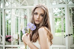 Romantic Woman with Flowers. Beautiful Fashion Model Royalty Free Stock Photography