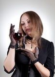 Romantic woman with glass of wine Stock Photography
