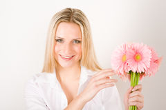 Romantic woman hold pink gerbera daisy flower Stock Photography