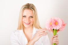 Romantic woman hold pink gerbera daisy flower Stock Photography