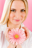Romantic woman hold pink gerbera daisy flower Royalty Free Stock Images