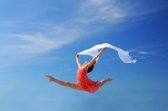 Romantic woman jumping Stock Images