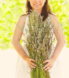 Romantic woman with lavender bouquet Royalty Free Stock Photo