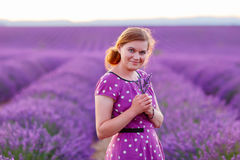 Romantic woman in lavender fields, having vacations in Provence,. France. Girl traveling through Valensole plateau Stock Photo