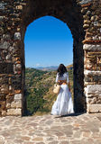 Romantic woman near arch of medieval town Royalty Free Stock Image