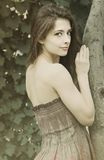 Romantic woman near tree looking Royalty Free Stock Photography