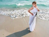 Romantic woman on sea background Royalty Free Stock Photo