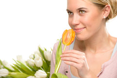 Romantic woman smell one orange tulip flower Royalty Free Stock Images