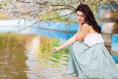 Romantic woman in a spring park Stock Photos