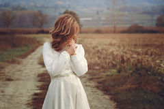 Romantic woman with vintage bride dress Stock Photos