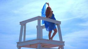 Romantic woman on watchtower. Sea vacation. Romantic concept stock video footage