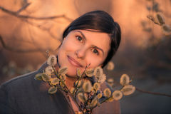 Romantic woman and willow twig Royalty Free Stock Images
