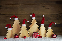 Romantic wooden christmas background with red santa hats and cra Royalty Free Stock Photo