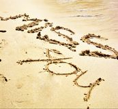 romantic words written on the sand Stock Images