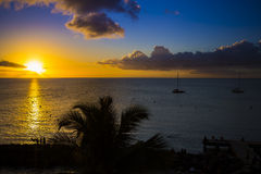 Romantic yellow sunset on a beach of Martinique. Romantic yellow sunset on the Caribbean beach of Martinique Royalty Free Stock Photos