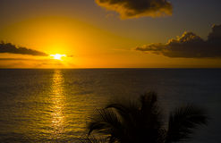 Romantic yellow sunset on a beach of Martinique. Romantic yellow sunset on the Caribbean beach of Martinique Royalty Free Stock Image