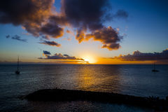 Romantic yellow sunset on a beach of Martinique. Romantic yellow sunset on the Caribbean beach of Martinique Stock Photography