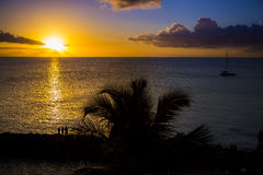 Romantic yellow sunset on a beach of Martinique Stock Photos