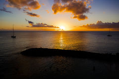 Romantic yellow sunset on a beach of Martinique. Romantic yellow sunset on the Caribbean beach of Martinique Stock Photos