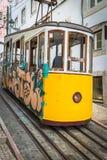 Romantic yellow tramway - main symbol of Lisbon, Portugal Stock Photo