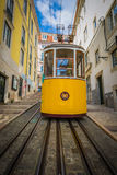 Romantic yellow tramway - main symbol of Lisbon, Portugal Stock Image