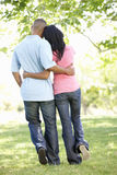 Romantic Young African American Couple Walking In Park Stock Photo