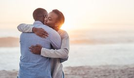 Content young African couple embracing each other at the beach royalty free stock image