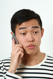 Romantic young Asian man using a smartphone Royalty Free Stock Photo
