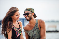 Romantic young beautiful couple in love laughing at the pier Stock Photos